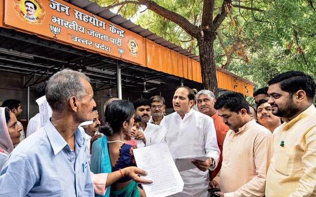 UP minister Suresh Rana (centre) at a Jan Sahyog Kendra at the BJP state HQ, Lucknow. Photo: Maneesh Agnihotri