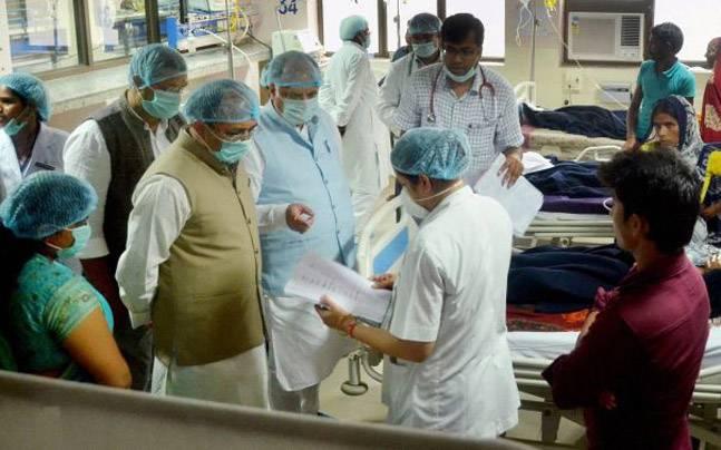Uttar Pradesh Health Minister Siddharth Nath Singh and Medical Education Minister Ashutosh Tandan at BRD Medical College hospital in Gorakhpur