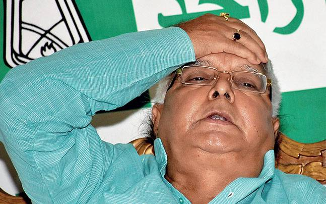 RJD Chief Lalu Prasad Yadav addressing a press conference after the RJD legislators' meet. Photo: PTI