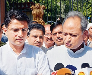 Rajasthan ex-CM Ashok Gehlot (R) is believed to be upset with the party decision to project Sachin Pilot (L) as the chief ministerial candidate.