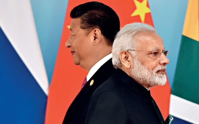 MISSED TARGETS: China's Xi Jinping and PM Narendra Modi at the BRICS summit group photo session in Xiamen, September 4, 2017