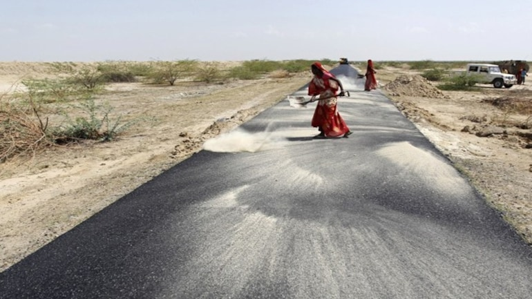 A woman working on a road construction project in Gujarat