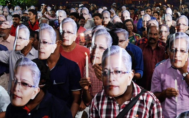 People wearing mask in a candle light vigil to pay tribute to senior journalist and activist Gauri Lankesh in Thiruvananthapuram. (Photo: PTI)