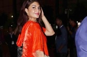 Jacqueline Fernandez stepped out in an orange, velvet night-suit