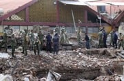 Mexico mourns 66 dead after twin punch of earthquake, hurricane