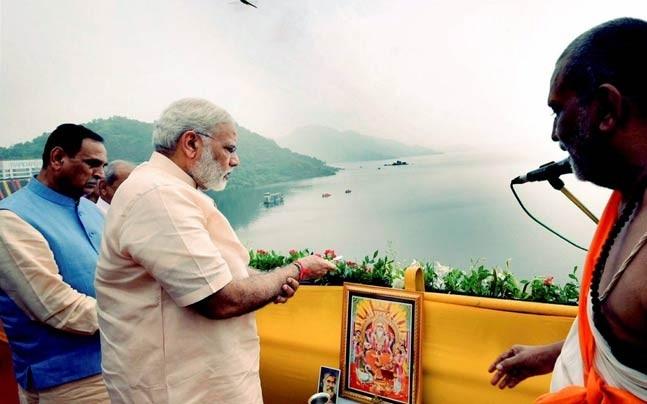Prime Minister Narendra Modi offers prayers to Narmada River during the inauguration of Sardar Sarovar Dam at Kevadiya in Narmada district on Sunday. (Photo: PTI)