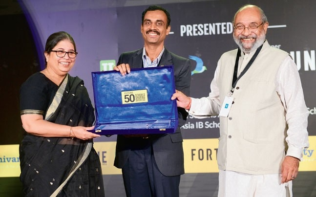 Vasant Valley School principal Rekha Krishnan (extreme left) receives an award at the 'Future 50 Schools Shaping Success' convention in the Capital on Friday. (Photo: Ramesh Sharma)