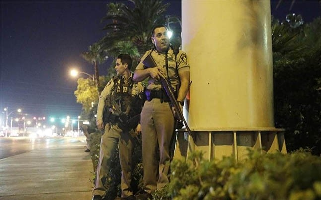 Police officers at the scene. Photo: AP