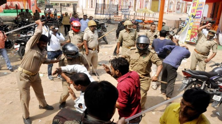 Police had to resort to lathicharge after a clash between two communities during a Muharram procession at Parampurva in Kanpur on Sunday. PTI Photo.