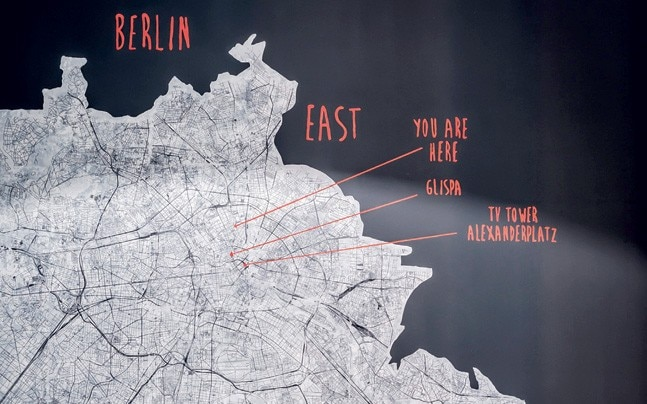 The bedroom has a poster with Berlin marked out for the German couple