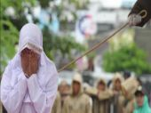 Couple flogged publicly in Indonesia for getting 'too close' to each other before marriage