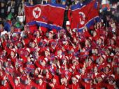 2018 Winter Olympics: North Korean cheerleaders sing 'We are one!' in Games culture clash