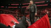 WWE Elimination Chamber: Ronda Rousey picks and slams Triple H down on a table. WATCH