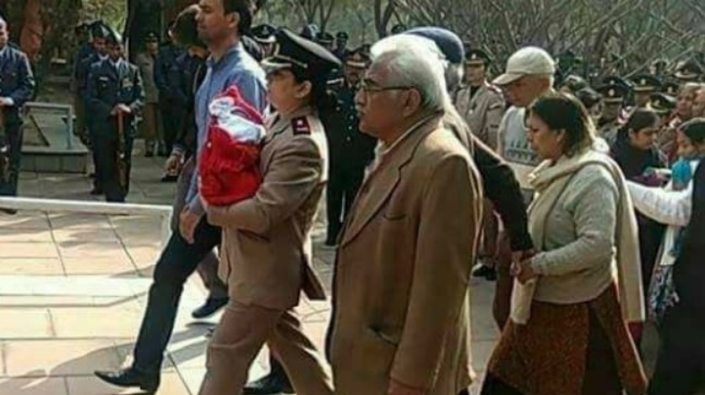 Major Kumud Dogra attending husband's funeral with 5-days-old daughter in her arms.
