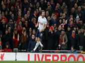 Premier League: Kane penalty helps Tottenham draw at Liverpool