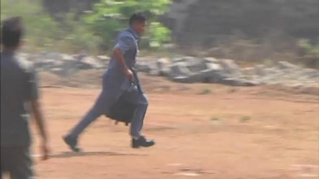 A security guard of KCR controlling the scare situation