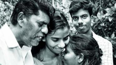 MJ Nithyamol (centre), one of the 46 nurses, with her family in Kottayam, Kerala.