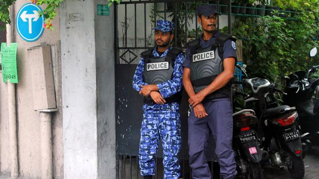 Maldivian police officers stand guard on a street after Maldives President Abdulla Yameen declared a state of emergency for 15 days, in Male, Maldives