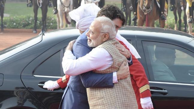Narendra Modi greets Justin Trudeau