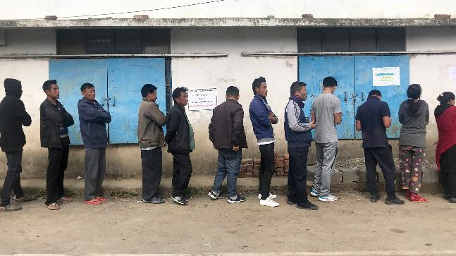 Nagas stand in a queue to cast their votes for the Nagaland state legislature elections outside a polling station in Kohima village. (AP Photo/Yirmiyan Arthur)