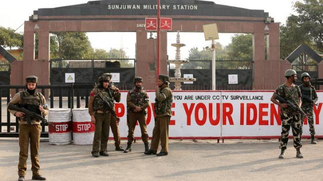 Indian Army soldiers stand guard outside an army camp after suspected militants attacked the camp, in Jammu.