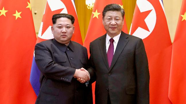 28 2018 by China's Xinhua News Agency North Korean leader Kim Jong Un left and Chinese President Xi Jinping shake hands in Beijing China