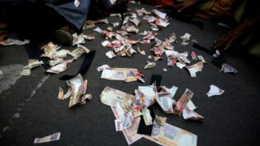 Pieces of old fake 1000 rupee notes lay on the street during a protest, organised by India's main opposition Congress party, to mark a year of demonetisation.