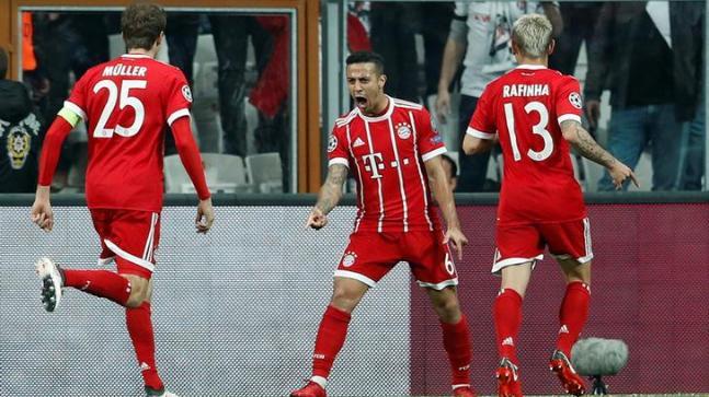 Thiago Alcantara celebrates with his FC Bayern Munich teammates
