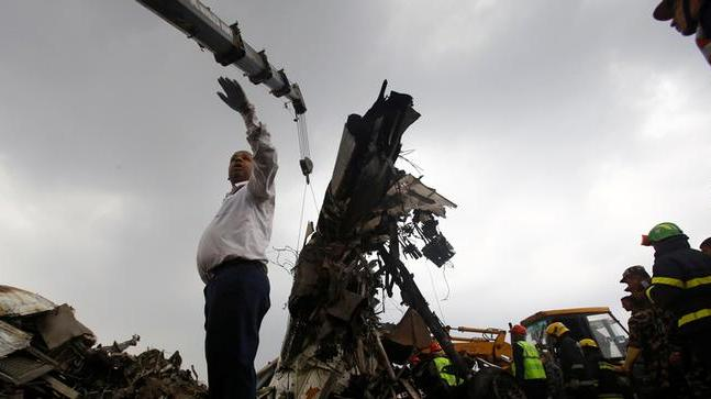 US-Bangla airplane after it crashed at TIA in Kathmandu, Nepal (Photo from Reuters)