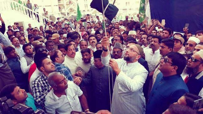 Asaduddin Owaisi (centre, in white kurta) and All India Majlis-e-Ittehad-ul Muslimeen leaders and workers at a flag-hoisting ceremony held on the occasion of the party's 60th anniversary.