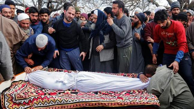 Relatives mourn in front of the body of Suhail Ahmad Wagay, a civilian who died in a gunbattle between suspected militants and Indian security forces, during his funeral procession at Pinjoora area of Kashmir's Shopian district. (Reuters)