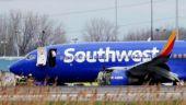 US plane makes emergency landing after woman sucked into broken window, 1 dead