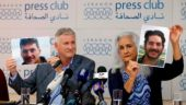 Marc and Debra Tice, the parents of Austin Tice, who has been missing in Syria since August 2012, hold up photos of him during a new conference, at the Press Club, in Beirut, Lebanon. (AP Photo/Bilal Hussein, File)