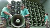 South Korean army soldiers remove loudspeakers used for propaganda near the demilitarized zone between South and North Korea, in Paju, South Korea. (AP Photo/ Lee Jin-man, File)