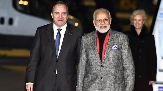 Prime Minister Narendra Modi arrives in Sweden, wearing a grey suit.
