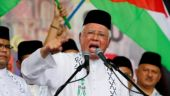 Malaysia's Najib dissolves parliament, paving way for tough election