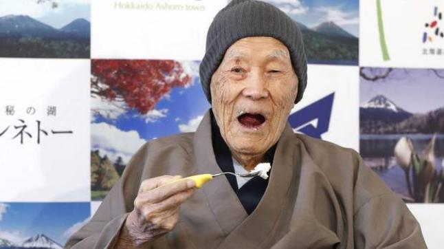 Oldest man enjoys candies, soaking in Japan's scorching springs