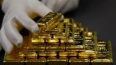 Gold hits one-week high on dollar weakness, geopolitical tensions