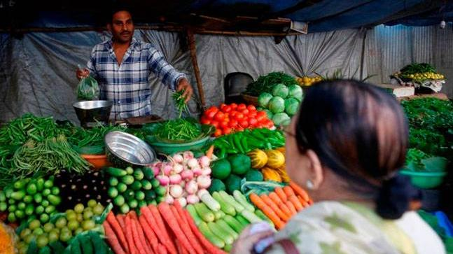 Deflating food prices softens India's WPI inflation