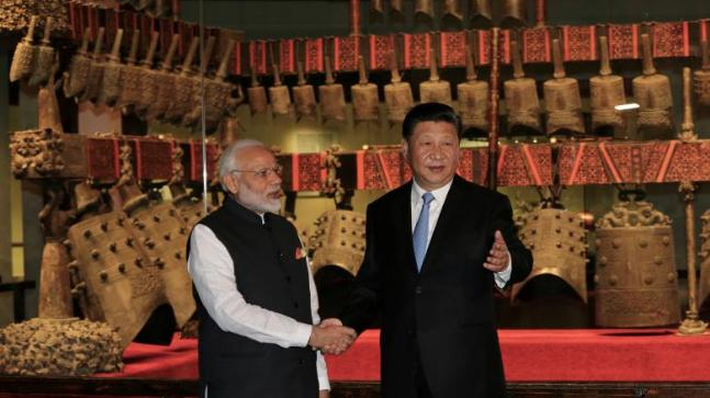 Chinese President Xi Jinping and Indian Prime Minister Narendra Modi shake hands as they visit the Hubei Provincial Museum in Wuhan Hubei province China