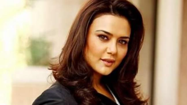 Preity Zinta does pilates stretching after her workout.