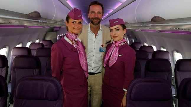 Skuli Mogensen, CEO of WOW air, poses with cabin crew members. (REUTERS/Pascal Rossignol/File Photo)