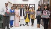 Akhilesh gives laptops to exam toppers, says BJP not honouring youth