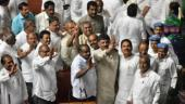 Chief Minister of Karnataka HD Kumaraswamy and Congress leader DK Shivkumar with the leaders of Congress and JD(S) after they won the trust vote at Vidhana Soudha on May 25 (Photo: Getty images)