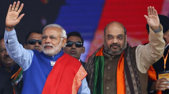 Indian Prime Minister Narendra Modi (L) and Amit Shah