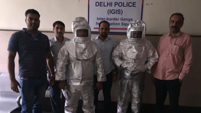 Police parade 'NASA conmen' wearing space suits in India