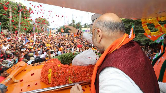 BJP chief Amit Shah at a road show in Sarvagnanagar assembly constituency, Bengaluru. (Photo: Twitter/@AmitShah)