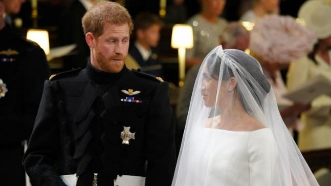 Prince Harry's expression on looking at Meghan Markle at the wedding was priceless.