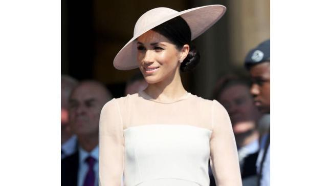 Meghan Markle looks a like rose in the spring sun.