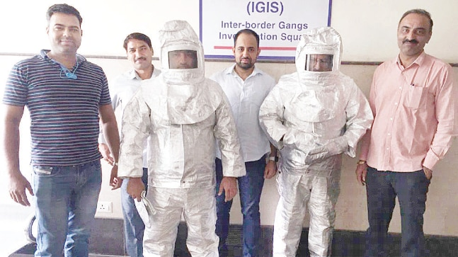Indian fraudsters ridiculed after being paraded in 'space suits'